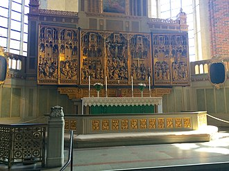 Strängnäs Cathedral - The high altar of Strängnäs Cathedral, showing detail of the sanctuary, and the very large carved and gilded triptych reredos.