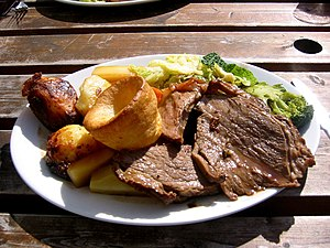 Roasting - A Sunday roast consisting of roast beef, roast potatoes, vegetables, and Yorkshire pudding