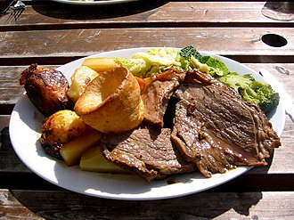 Sunday roast - Sunday roast typically consists of roast beef, roast potatoes, other vegetables and Yorkshire pudding.