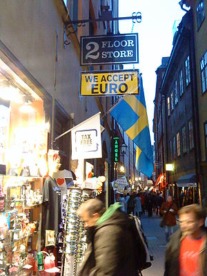 Sweden and the euro - Shop in Stockholm that accepts euros, in the tourist district. Signs like this one are not so common in Stockholm.