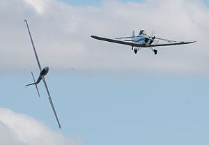 Aerobatics - The UK Swift Aerobatic Display Team at Kemble Battle of Britain Weekend 2009. A Swift glider is performing continuous full rolls while towed by a Piper Pawnee