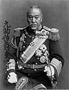 photograph of Tōgō in full dress uniform with elaborate epaulettes, a sash, and cuff insignia