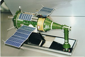 TKS (spacecraft) - A model of a TKS spacecraft. On the left is the cylindrical Functional Cargo Block with attached solar panels. In the middle is the VA spacecraft, with the conical VA return capsule for the crew and the VA's orbital manoeuvring engines in the long nose section. Standing right front is the launch escape system, which would have been attached to the top of the VA's nose section during launch and jettisoned after a successful launch.