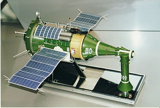 TKS (spacecraft) - A model of a TKS spacecraft. On the left is the cylindrical Functional Cargo Block with attached solar panels. In the middle is the VA spacecraft, with the conical VA return capsule for the crew and the VA's orbital maneuvering engines in the long nose section. Standing right front is the launch escape system, which would have been attached to the top of the VA's nose section during launch and jettisoned after a successful launch.