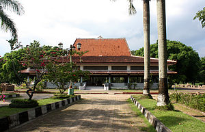 Sriwijaya Kingdom Archaeological Park - The main pavilion in Palembang Limasan traditional architecture in the middle of Nangka island. The pavilion hosts a replica of Kedukan Bukit Inscription.