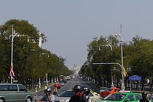 Ratchadamnoen Avenue - Ratchadamnoen Avenue viewed northwards from Phan Fa Lilat Bridge. Ananta Samakhom Throne Hall is visible in the distance.