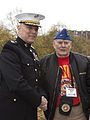 The Assistant Commandant of the Marine Corps, Gen. John M. Paxton, Jr., left, poses for a photo with a Marine veteran during an Honor Flight event at the Marine Corps War Memorial in Arlington, Va., Sept 131112-M-KS211-011.jpg