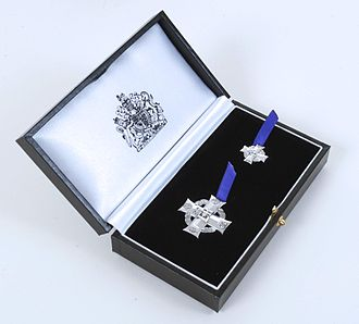 Elizabeth Cross - The medal, and a miniature version, are presented in a black leather-style presentation box with the Royal Cypher on the lid and the Royal Coat of Arms on the inner silk lining.