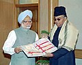 The Governor Jharkhand Shri Syed Sibtey Razi presenting a cheque for Rs.1.10 crore to Prime Minister Dr. Manmohan Singh towards PMNRF for Tsunami Victims in New Delhi on February 2, 2005.jpg