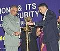 The Home Minister Shri Shivraj Patil lighting the lamp at the Annual Alumni Meet – 2006 of the Delhi College of Engineering (DCE), in New Delhi on January 14, 2006.jpg
