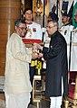 The President, Shri Pranab Mukherjee presenting the Padma Bhushan Award to Dr. Swapan Dasgupta, at a Civil Investiture Ceremony, at Rashtrapati Bhavan, in New Delhi on March 30, 2015.jpg