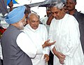 The Prime Minister, Dr. Manmohan Singh is being welcomed by the Governor of Orissa Shri Rameshwar Thakur and Chief Minister of Orissa Shri Naveen Patnaik at Biju Patnaik Airport, Bhubaneswar, Orissa on August 28, 2006.jpg