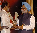 The Prime Minister, Dr. Manmohan Singh presented the Entertainer of the Year Award to Shri Rajnikanth, at the 'NDTV Indian of the Year Awards Function', in New Delhi on January 17, 2008.jpg