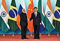 The Prime Minister, Shri Narendra Modi being welcomed by the President of the People's Republic of China, Mr. Xi Jinping, at the 9th BRICS Summit, in Xiamen, China on September 04, 2017.jpg