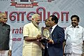 The Prime Minister, Shri Narendra Modi presenting the Special Award to Shri V.G. Santhosam, on the occasion of the Platinum Jubilee of the Daily Thanthi, in Chennai.jpg