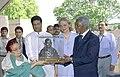 The Secretary General, United Nations Mr. Kofi Annan and his wife Mrs. Nane Annan are being presented a memento at the Samadhi of Mahatma Gandhi at Rajghat in Delhi on April 27, 2005.jpg