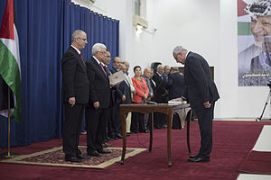 Palestinian Unity Government of June 2014 - Riyad Al-Maliki the foreign minister swear in front of the Palestinian president Mahmoud Abbas, at Al-Muqata'a H.Q. in Ramallah.