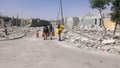 These men walk about one-half kilometer to the nearest water provided by a local charity - Sanaa - Oct-9-2015.png