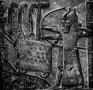 Military history of the Neo-Assyrian Empire - An image of Tiglath Pileser III's troops (not II). In the background can be seen a siege engine.