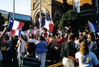National Acadian Day - Celebration of National Acadian Day in Fredericton, New Brunswick, with a traditional tintamarre and Acadian flags