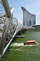 Tour boat passes beneath Helix Bridge in Singapore.jpg