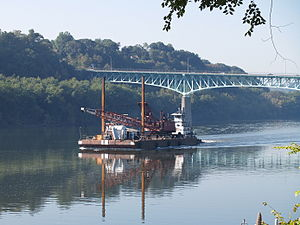 Tarentum, Pennsylvania - The towboat Annette G pushing a dredger crane barge just upstream from the George D. Stuart Bridge (commonly called the Tarentum Bridge)