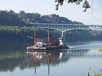 Tarentum, Pennsylvania - The towboat Annette G pushing a dredger crane barge just upstream from the George D. Stuart Bridge (commonly called the Tarentum Bridge)