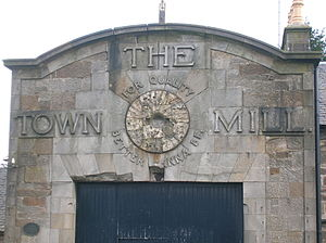 Strathaven - Detail of the advertisement on the town mill