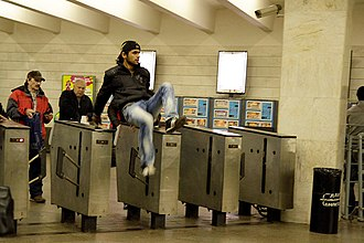 Fare evasion - Image: Turnstile jumping in Moscow Metro (1)