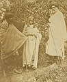 Two Toda men and a woman from the Nilgiri Hills in Tamil Nadu in 1871.jpg