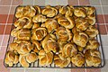 Two layers of cardamom buns on grate.jpg
