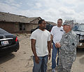 U.S. Army 1st Lt. Roderick Jones, left, with the 1345th Transportation Company, Oklahoma Army National Guard, tells Army Maj. Gen. Myles Deering, right, the adjutant general of Oklahoma, about his house being 130525-Z-VF620-4057.jpg