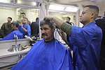 U.S. Marines experience the USS Anchorage barbershop 151207-M-TJ275-345.jpg