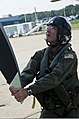 U.S. Navy Capt. Jeffrey Davila, the commanding officer of Air Test and Evaluation Squadron (VX) 1, performs preflight checks on an E-2D Hawkeye aircraft before his final flight at Naval Air Station Patuxent 130827-N-OY799-030.jpg