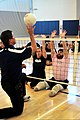 U.S. Navy Chief Gunner's Mate Jeanette Tarquena, center, and Explosive Ordnance Disposal Technician 1st Class John Kremer, right, block a ball during a sitting volleyball practice session for the Wounded Warrior 140107-N-QN361-016.jpg
