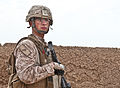 U.S. Navy Petty Officer Third Class Brandon Henthorne with Weapons Company, 2nd Battalion, 7th Marine Regiment, stands guard during the sweep of a compound near Patrol Base Boldak, Afghanistan, March 7, 2013 130307-M-DE426-008.jpg