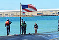U.S. Sailors change flags aboard the attack submarine USS Jacksonville (SSN 699) as the submarine arrives for maintenance in Apra Harbor, Guam, April 9, 2013 130409-N-LS794-205.jpg