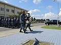 U.S. Sailors stand in formation as Information Systems Technician 1st Class Brandon M. Donaldson, left, and Logistics Specialist 1st Class Dat Do carry a wreath during a 9-11 commemoration ceremony at Misawa Air 140911-N-EC644-046.jpg