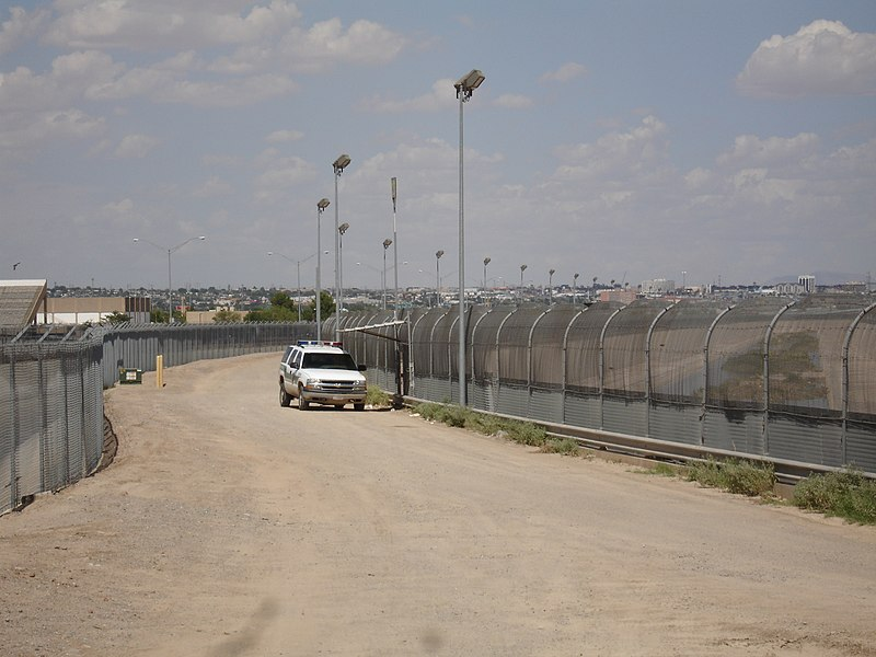 This is a high resolution version of Image:US-Mexico border fence.jpg. This type of border fence almost always appears at the border crossing. Usually a rickety fence is in most other locations.