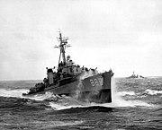 USS Orleck (DD-886) underway in heavy seas, in the 1950s