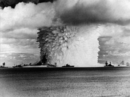 USS Saratoga (CV-3) and other ships are hit by Crossroads Baker nuclear blast, 25 July 1946.jpg