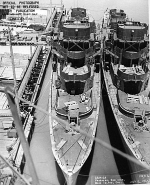 USS Sederstrom (DE-31) and USS Fleming (DE-32) fitting out at the Mare Island Naval Shipyard on 7 July 1943