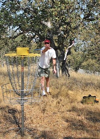 Flying disc games - Disc golf pole hole, a standardized disc golf target created by Ed Headrick.