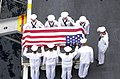 US Navy 020903-N-1974E-002 A burial at sea detail commends the remains of a shipmate to the sea.jpg