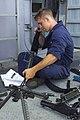 US Navy 030103-N-9867P-004 Gunner's Mate 3rd Class Nicholas Barnett performs maintenance on an M-60 machine gun.jpg