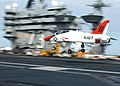 US Navy 030131-N-8213G-001 A T-45A Goshawk makes a final approach with tail hook down during an arrested landing.jpg