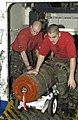 US Navy 030320-N-1397H-006 Aviation Ordnancemen move ordnance out of a weapons elevator to a bomb handling assembly area.jpg