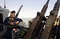 US Navy 030321-N-0000G-008 Sailor scans the horizon for contacts and potential aggressors from aboard the Cyclone Class patrol boat, USS Chinook (PC 9).jpg