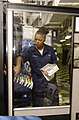 US Navy 030403-N-2143T-003 Ship's Serviceman Seaman Brown stocks a vending machine aboard USS Nimitz (CVN 68).jpg