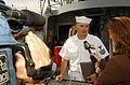 US Navy 040430-N-1464F-002 Engineman 1st Class William Auriemma speaks with WTKR Norfolk Channel 3 news reporter Stacey Davis.jpg